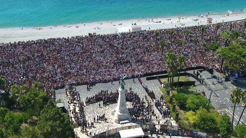 Thousands gather on Monday on the Jardin Albert and the Promenade des Anglais in Nice to observe a minute of silence for victims of the deadly attack.