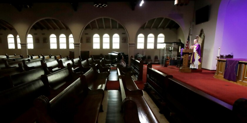 A priest is recorded celebrating Mass in an empty St. Brendan the Navigator Catholic Church in San Francisco on March 29.