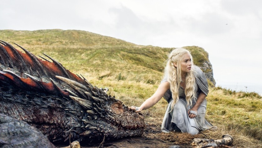 "In this image released by HBO, Emilia Clarke appears in a scene from ""Game of Thrones."" Clarke was nominated for an Emmy Award on Thursday for outstanding supporting actress in a drama series for her role on the show. The 67th annual Primetime Emmy Awards will take place on Sept. 20, 2015."