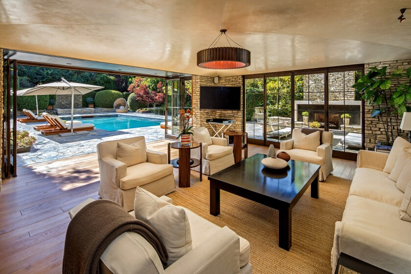 The Wallace Neff-designed house, once owned by Brad Pitt and Jennifer Aniston, sold for $32.5 million.