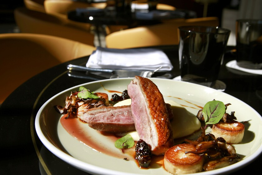 Grilled duck breast with umeboshi, ginger pomme puree and mushrooms is a favorite at Paley.