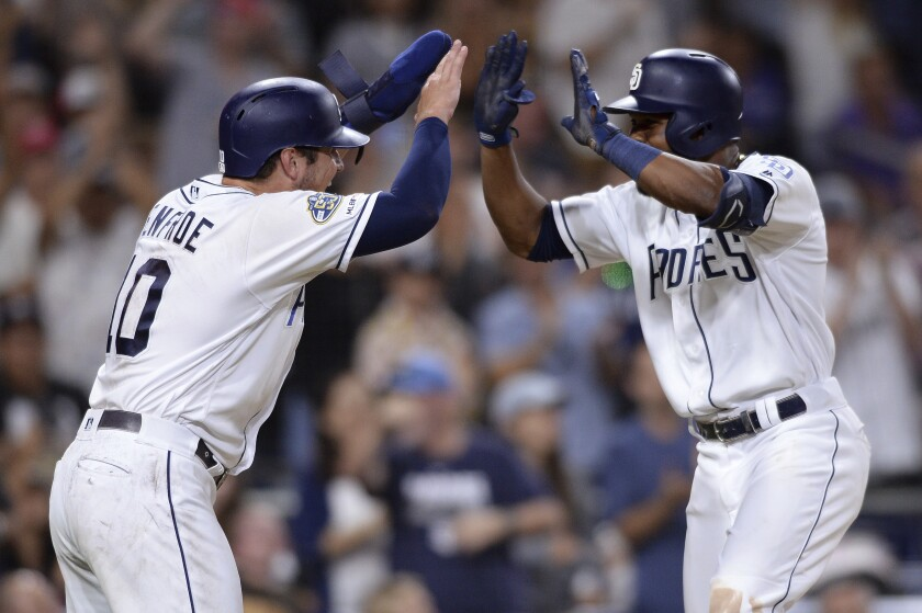 Manuel Margot, right, is congratulated by Hunter Renfroe after hitting a two-run homer in the eighth inning Saturday against the Rockies.
