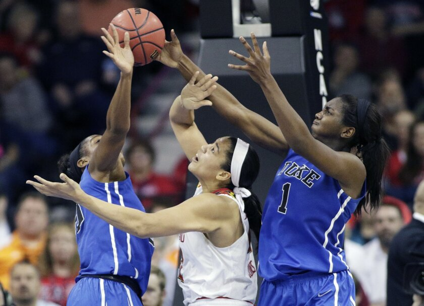 Maryland's Brionna Jones, center, goes after a rebound against Duke's Elizabeth Williams (1) and Duke's Amber Henson during the second half of a women's college basketball regional semifinal game in the NCAA tournament, Saturday, March 28, 2015, in Spokane, Wash. Maryland won 65-55. (AP Photo/Young