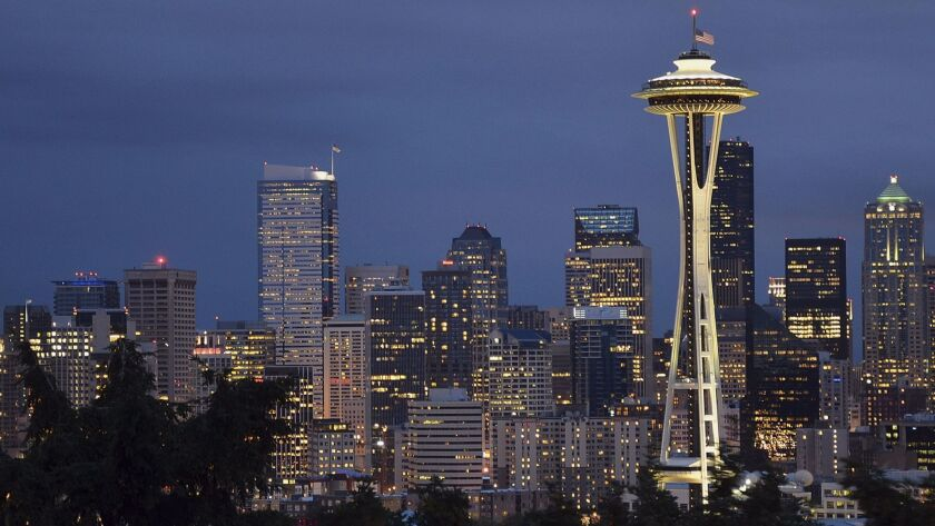 Seattle's Space Needle, which opened in 1962, helped give the city its current identify.