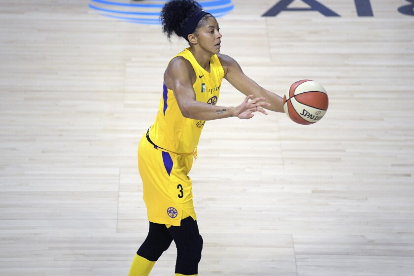 Sparks forward Candace Parker passes the ball against the Mercury on July 25, 2020, in Bradenton, Fla.