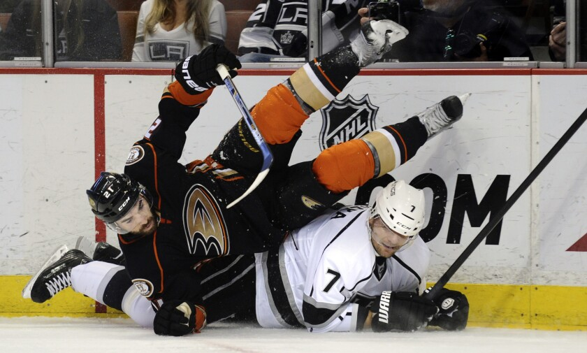 The newest of the Kings, Andrej Sekera, finds himself under the Ducks' Kyle Palmieri during the first period Friday at Honda Center.