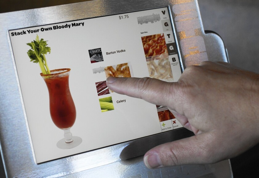 Touch-screen tablets let customers order food as well as drinks, such as this Bloody Mary at the new Stacked in Huntington Beach.