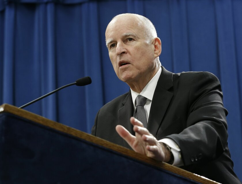 Gov. Jerry Brown discusses his proposed 2015-16 state budget at a news conference in Sacramento, Calif., Friday, Jan. 9,  2015. (AP Photo/Rich Pedroncelli)
