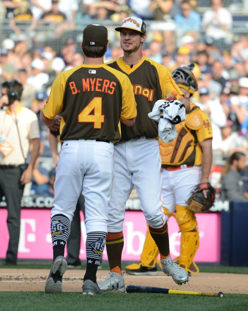 Jul 11, 2016; San Diego, CA, USA; National League infielder Wil Myers (4) of the San Diego Padres greets brother Beau Myers during the All Star Game home run derby at PetCo Park. Mandatory Credit: Jake Roth-USA TODAY Sports ** Usable by SD ONLY **