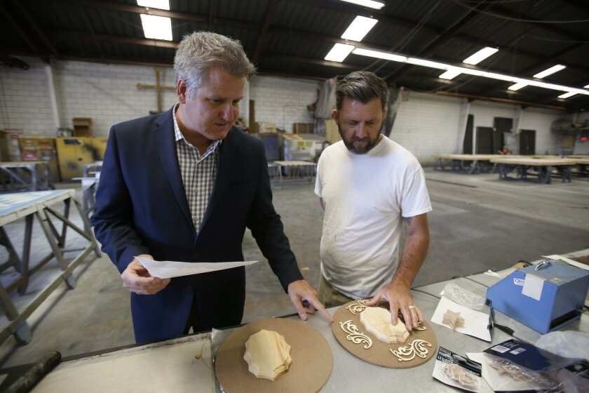 David Bennett, general director of San Diego Opera, and charge scenic artist Tim Wallace, look over details of a memory city the arts organization is building for Glenner Center, which runs three day-care centers for Alzheimer's and dementia patients in San Diego. The project, Town Square, is belie