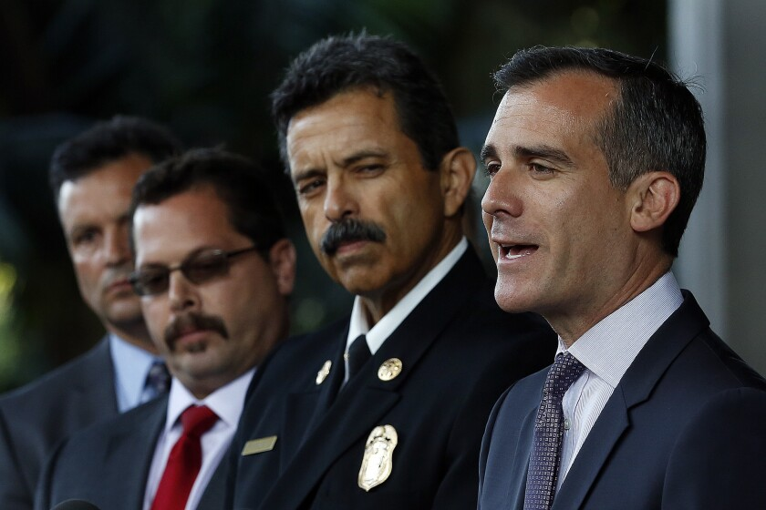 Mayor Eric Garcetti, right, addresses the media outside City Hall East. Beside him is LAFD Fire Chief Ralph Terrazas.