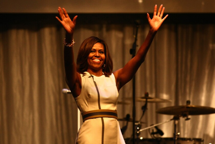 First Lady Michelle Obama arrives at the Grammy Museum-sponsored Jane Ortner Education Award Luncheon at Club Nokia on Wednesday to give the keynote speech.