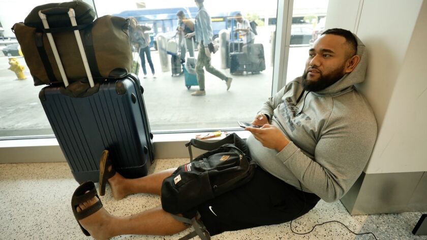 Freddy Lafoou, 25 from Bay Area slept in terminal 1 through the night as he flys Southwest Airlines
