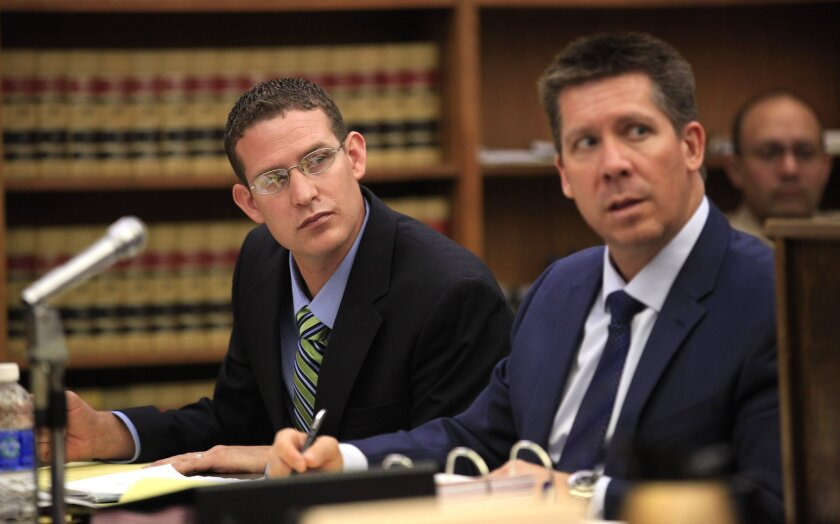 Former San Diego Police officer Christopher Hays, left, on the first day of his preliminary hearing with his layer, Kerry L. Armstrong.
