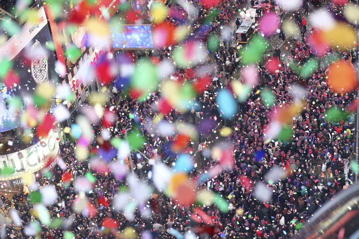 Confetti flies over New York's Times Square after the clock strikes midnight during the New Year's Eve celebration as seen from the New York Marriott Marquis hotel, Friday, Jan. 1, 2016.