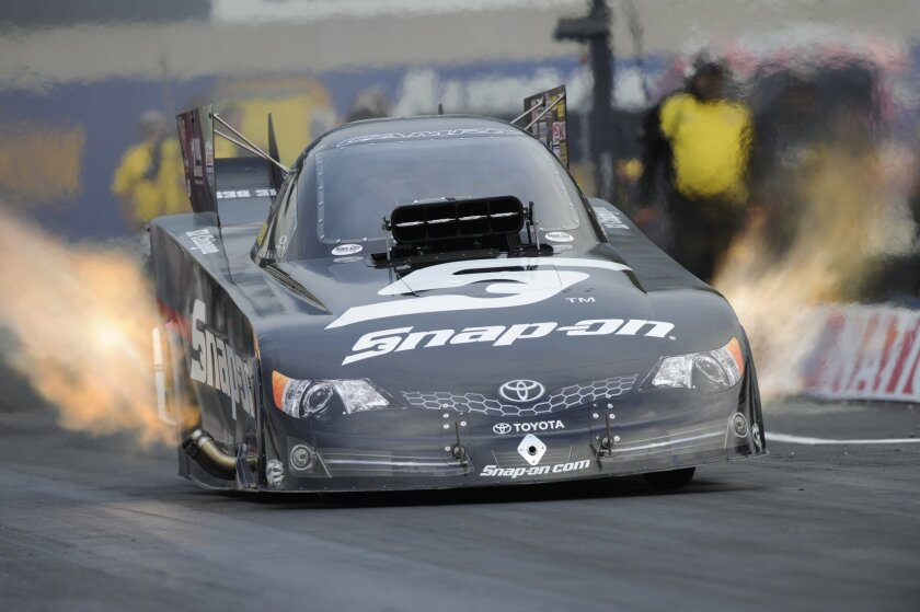 In this photo provided by NHRA, Cruz Pedregon races to the qualifying lead in Funny Car on Friday, Oct. 3, 2014, at the NHRA Nationals drag races at Maple Grove Raceway in Mohnton, Pa. Pedregon drove to a run of 3.991 seconds at 319.52 mph. (AP Photo/NHRA, Jerry Foss)