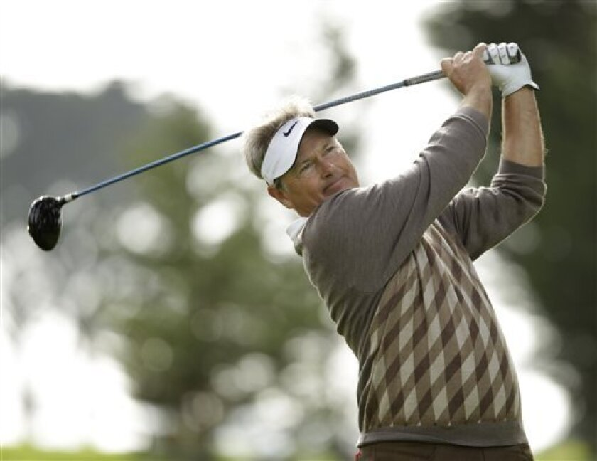 John Cook follows his drive from the sixth tee during the second round of the Charles Schwab Cup Championship golf tournament in San Francisco, Friday, Nov. 5, 2010. Cook leads the tournament by one stroke after shooting a 2-under-par 69 to finish at total 9-under-par. (AP Photo/Eric Risberg)