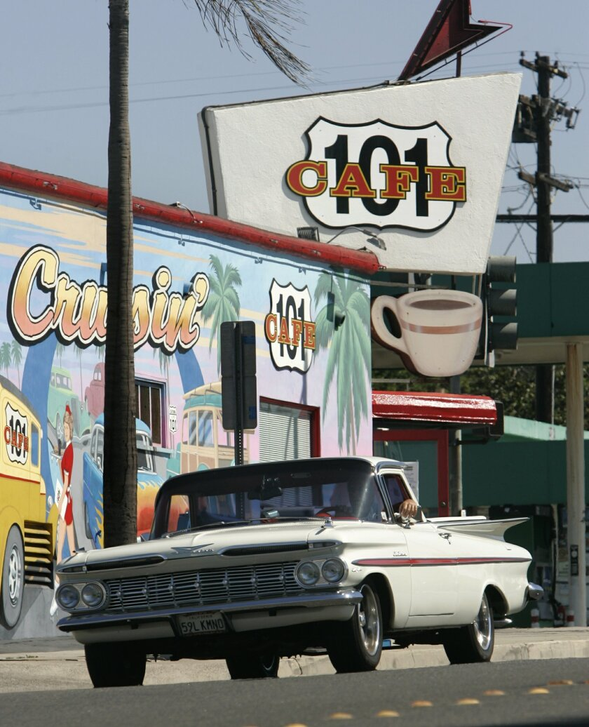 A classic car passes the 101 Cafe in Oceanside in this file photo.