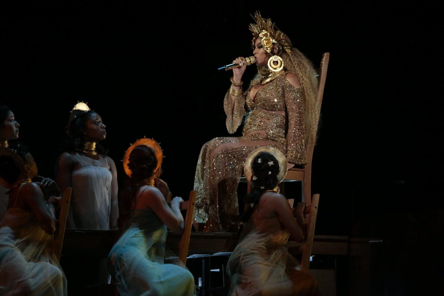 Beyoncé, on a throne, performs at the 59th Grammy Awards.