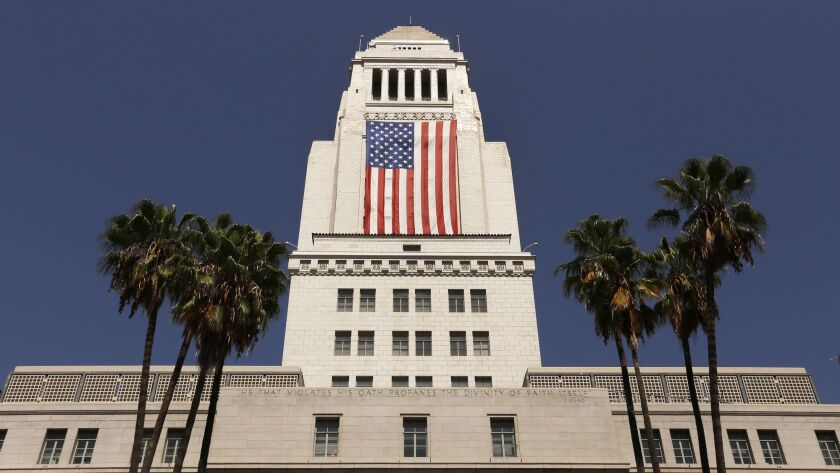 The American flag is draped on the south side of Los Angeles City Hall on Sept. 8, 2017.