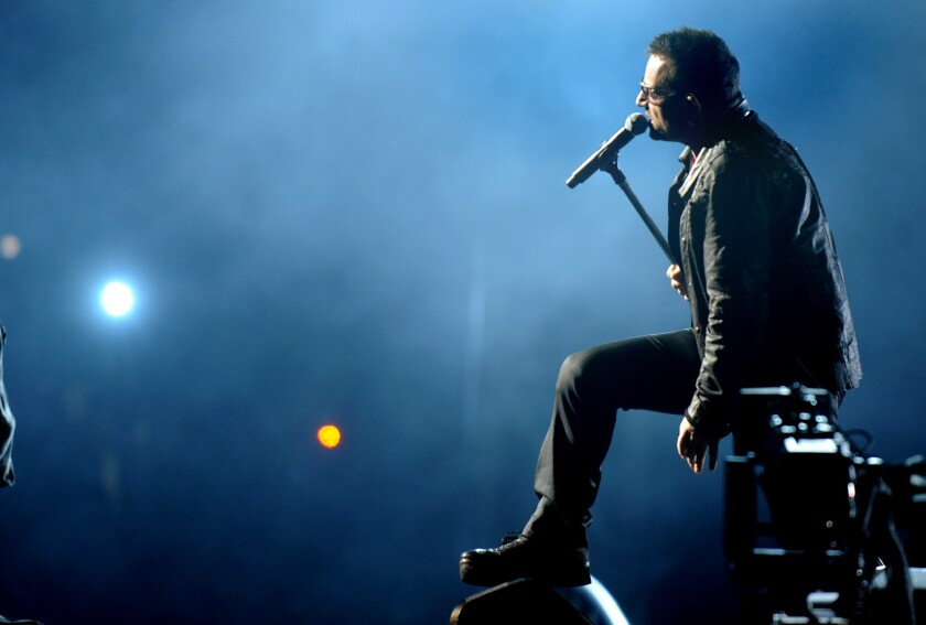 Bono of U2 performs at the Rose Bowl in Pasadena in 2009. The group will return to Los Angeles to perform at KROQ's annual charity concert, Almost Acoustic Christmas, in December.
