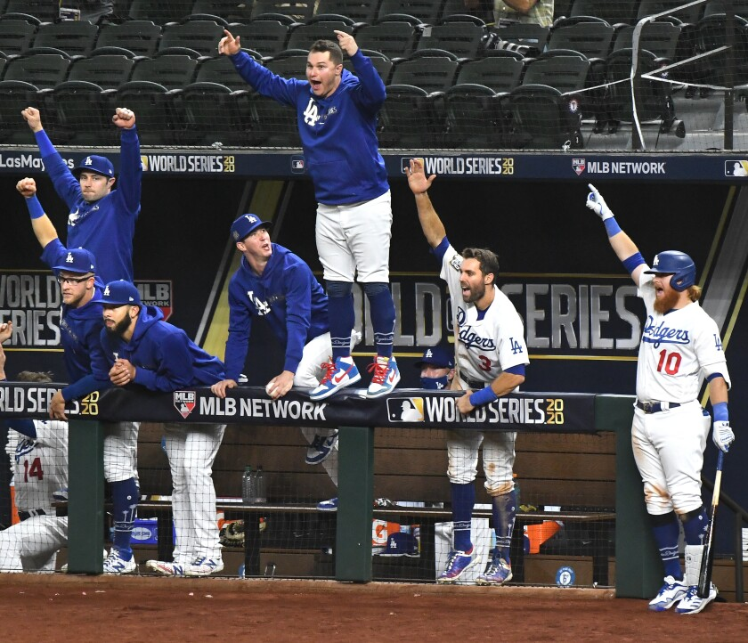 The Dodgers dugout erupts on a home run by Mookie Betts in the sixth inning against the Rays in Game 1.