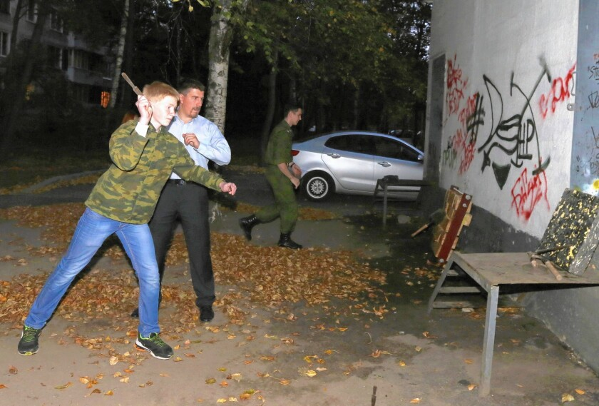 Stepan Zotov offers knife- and spade-throwing instruction to members of Our Army, a paramilitary youth group, in north Moscow.
