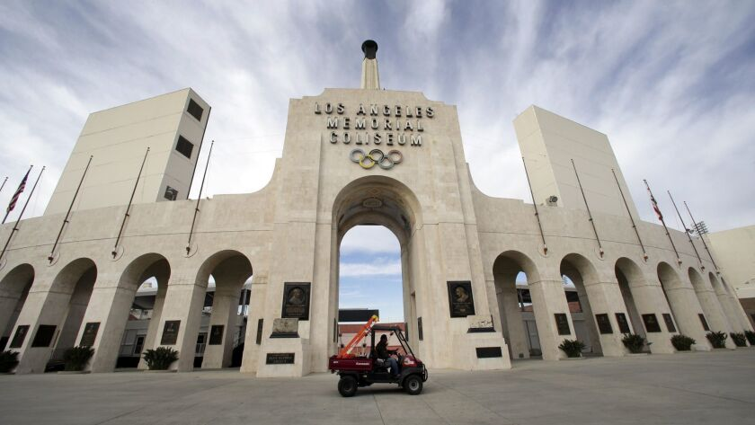USC's sale of naming rights for Los Angeles Memorial Coliseum is being criticized as dishonoring the historic stadium's dedication as a memorial to soldiers who fought and died in World War I.