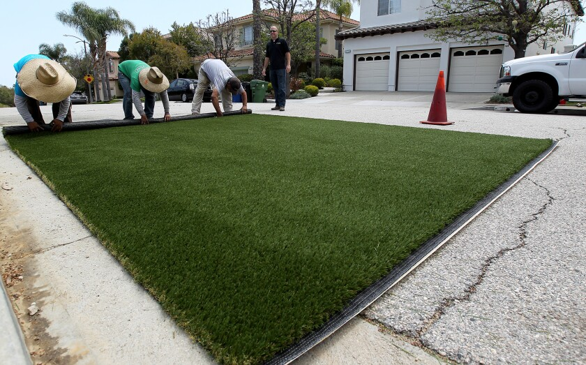 Artificial grass being prepared for installation in Pacific Palisades
