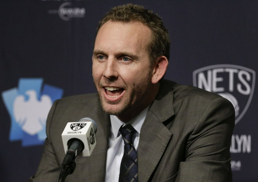 Sean Marks answers questions during a news conference where he was introduced as the new general manager of the Brooklyn Nets, before the Nets' NBA basketball game against the New York Knicks, Friday, Feb. 19, 2016, in New York. (AP Photo/Julie Jacobson)