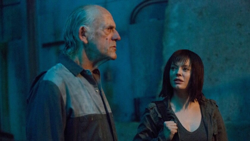 """Christopher Lloyd and Rose McGowan in the movie """"The Sound."""""""