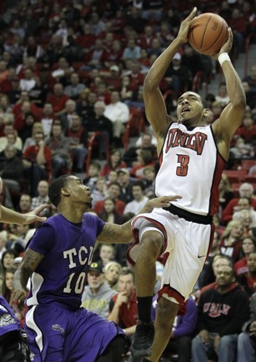 UNLV's Anthony Marshall (3) goes up for a shot against TCU's Hank Thorns in the second half of an NCAA basketball game, Saturday, Jan. 8, 2011 in Las Vegas. UNLV won 83-49. (AP Photo/Julie Jacobson)