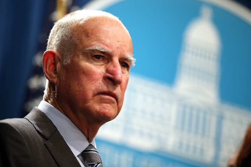 Then-Gov. Jerry Brown speaks at a news conference in Sacramento in 2015.