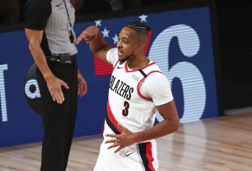 Portland Trail Blazers guard CJ McCollum (3) celebrates after scoring a 3-pointer against the Los Angeles Lakers during the first half of Game 3 of an NBA basketball first-round playoff series, Saturday, Aug. 22, 2020, in Lake Buena Vista, Fla. (Kim Klement/Pool Photo via AP)