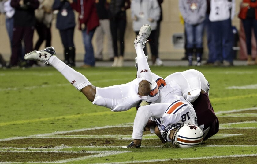 Auburn defensive back Carlton Davis (18) intercepts a pass in the end zone intended for Texas A&M wide receiver Damion Ratley, right, during the first quarter of an NCAA college football game, Saturday, Nov. 7, 2015, in College Station, Texas. (AP Photo/David J. Phillip)
