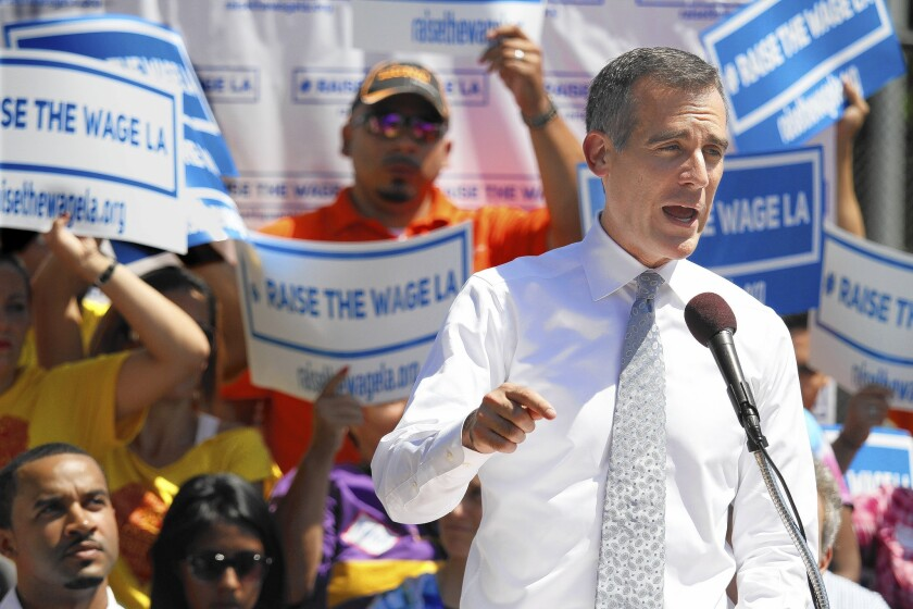 """Mayor Eric Garcetti called for a higher minimum wage, saying: """"We are reminding a nation that it is a crime for people to live in this rich nation and receive starvation wages."""""""