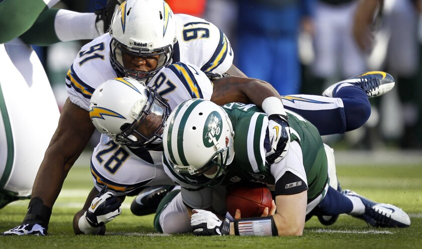 Chargers Brandon Taylor (28) and Kendall Reyes sack Jets Greg McElroy in the 1st quarter.