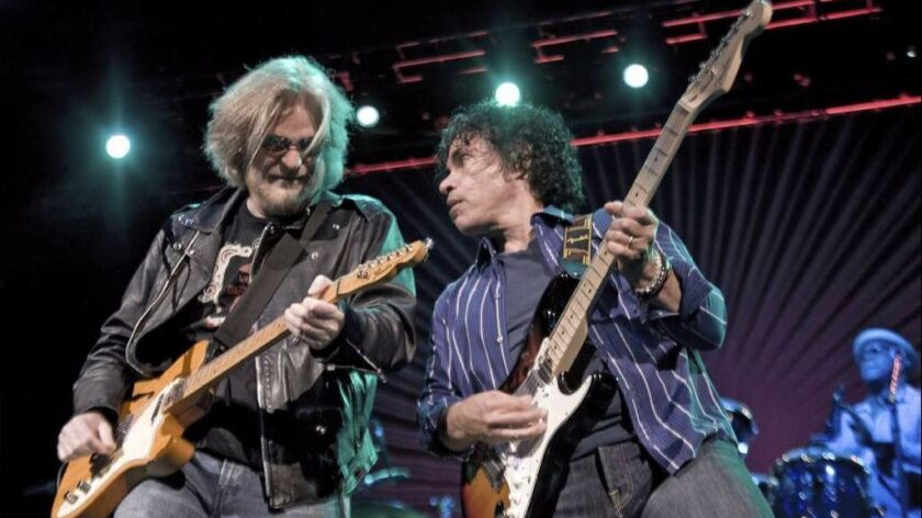 Daryl Hall (left) and John Oates thrive together on concert stages.