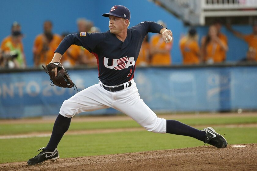 United States pitcher Buddy Baumann throws to Canada during the fifth inning of the gold medal baseball game at the Pan Am Games, Sunday, July 19, 2015, in Ajax, Ontario. (AP Photo/Julio Cortez)