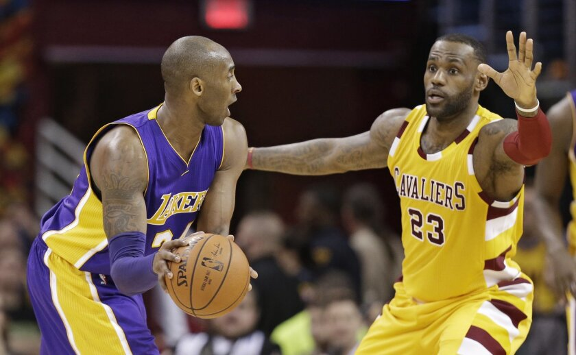 Cleveland Cavaliers' LeBron James (23) guards Los Angeles Lakers' Kobe Bryant (24) in the second half of an NBA basketball game Wednesday, Feb. 10, 2016, in Cleveland. The Cavaliers won 120-111. (AP Photo/Tony Dejak)