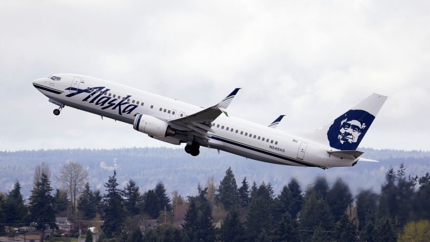 In this photo taken March 24, 2015, an Alaska Airlines jet takes off at Seattle-Tacoma International
