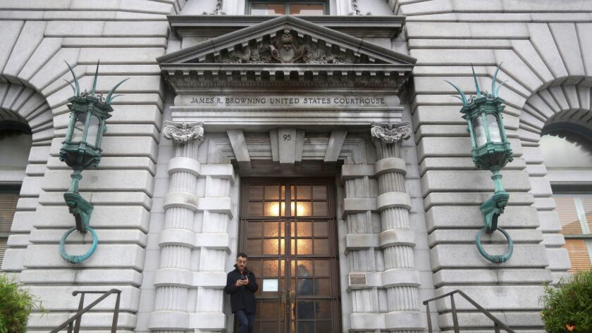 A man stands outside the main door outside the 9th U.S. Circuit Court of Appeals building in San Francisco on Feb. 15.