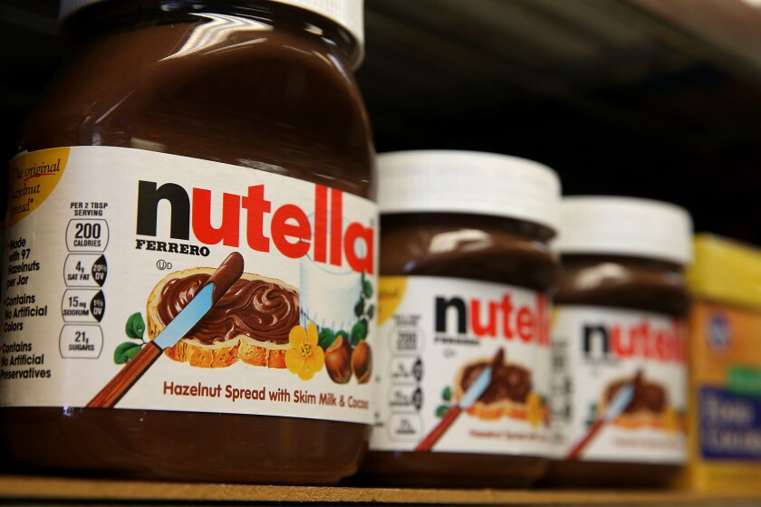 Jars of Nutella are displayed on a shelf at a market in San Francisco, Calif. on Aug. 18, 2014.