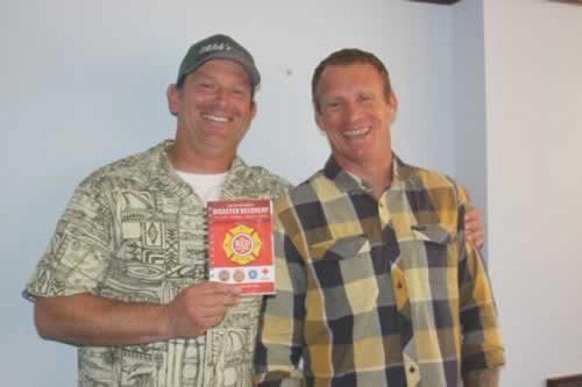 Author Sean Scott with friend and collaborator Nick Ferreira and 'The Red Guide to Recovery.' Ashley Mackin