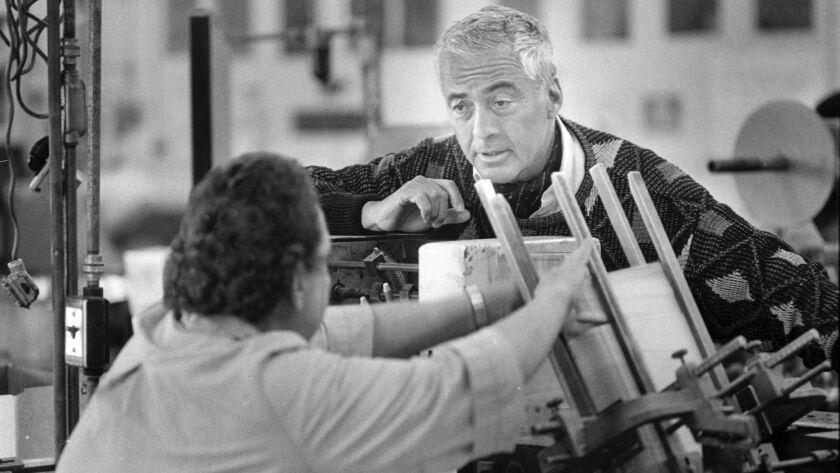 Lloyd Cotsen talks to a worker the Neutrogena factory in 1988.