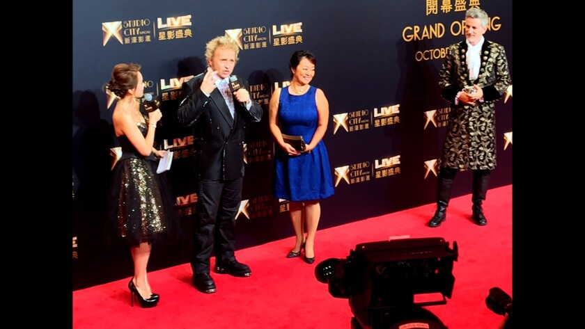 L.A.-based magician Franz Harary, wife Akiko and illusionist Travis Winkler at the opening of his House of Magic at a casino resort called Studio City in Macau, China.