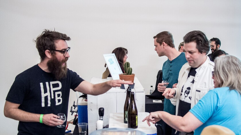 Highland Park Brewery's Bob Kunz, left, talks beer with festival attendees at a recent L.A. beer fes