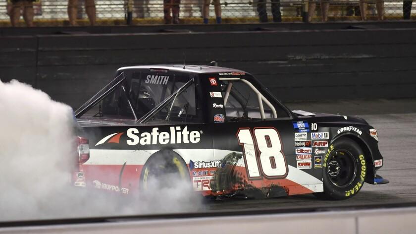 Chandler Smith celebrates his win in the NASCAR Truck Series auto race Thursday, Sept. 16, 2021, at Bristol Motor Speedway in Bristol, Tenn. (David Crigger/Bristol Herald Courier via AP)