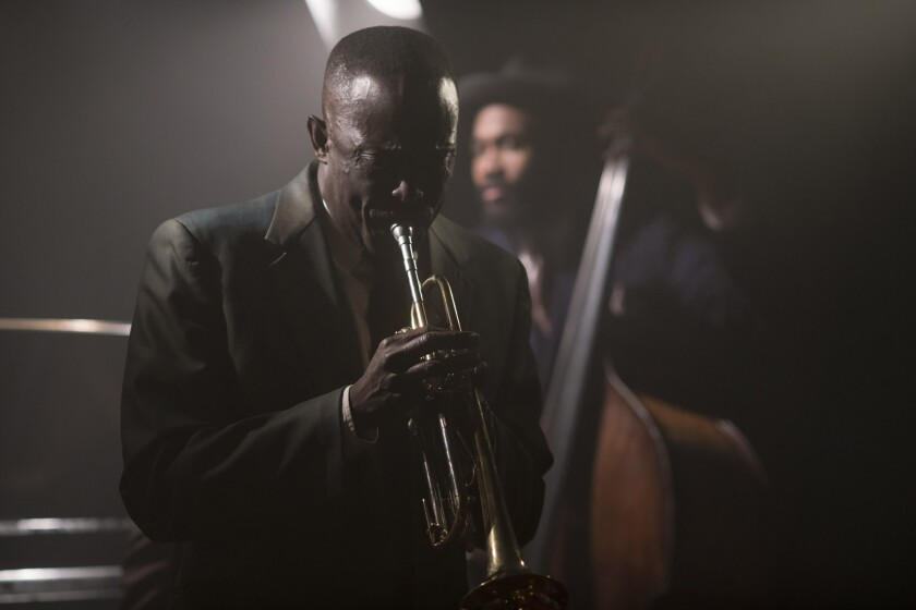 "Michael K. Williams, playing Trumpet Man in a scene from ""Motherless Brooklyn."""