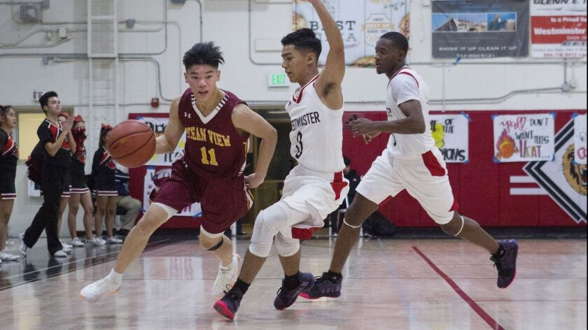 Ocean View's Carson Nguyen dribbles past Westminster's defense during a Golden West League game on W
